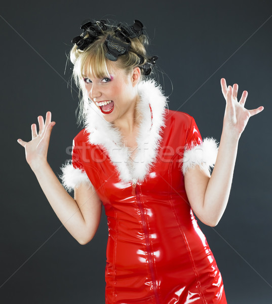 Santa Claus with rollers Stock photo © phbcz