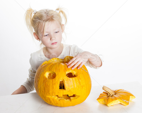 little girl carving pumpkin for Halloween Stock photo © phbcz