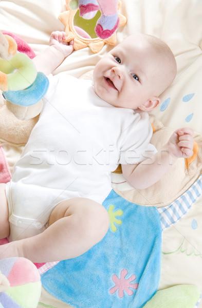baby girl lying down on playing mat Stock photo © phbcz