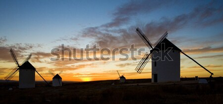 windmills at sunset, Campo de Criptana, Castile-La Mancha, Spain Stock photo © phbcz