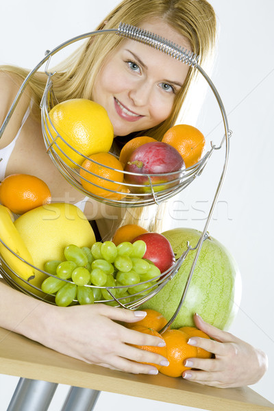 woman during breakfast with fruit Stock photo © phbcz