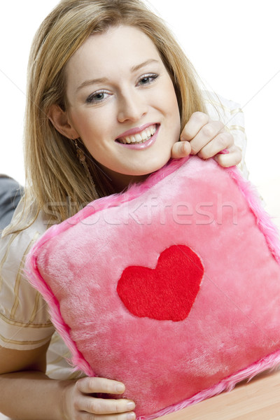 portrait of woman holding a pillow with heart Stock photo © phbcz