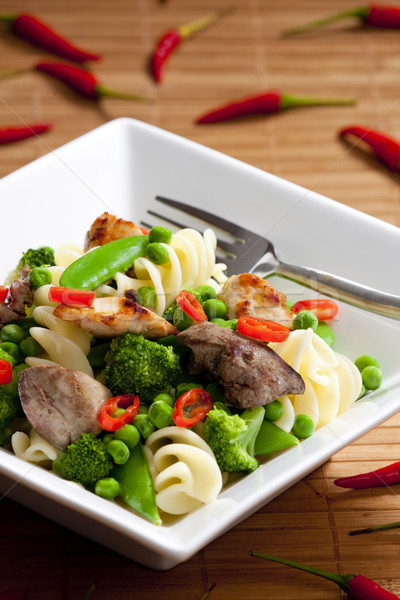 pasta with green vegetables and poultry meat Stock photo © phbcz