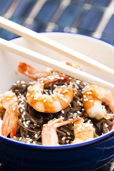 Japanese buckwheat noodles with prawns, soya sauce and sesame Stock photo © phbcz