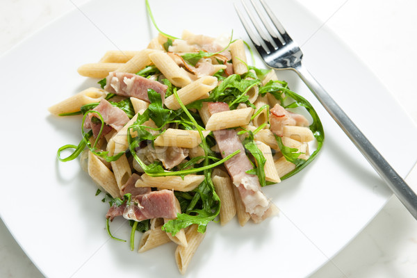 penne pasta with Parma ham and ruccola Stock photo © phbcz