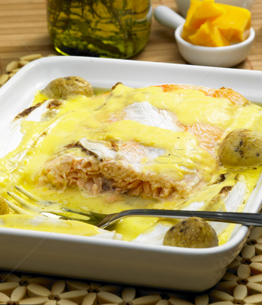 salmon and endive baked with chedar sauce Stock photo © phbcz