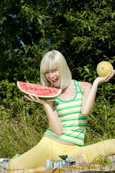 woman with melons at a picnic Stock photo © phbcz