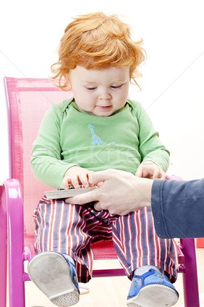 little boy with a book sitting on chair Stock photo © phbcz