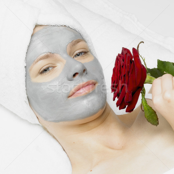 Stock photo: woman with facial mask and rose