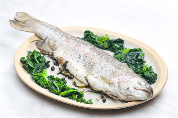 bream baked with Italian herbs and fried spinach Stock photo © phbcz