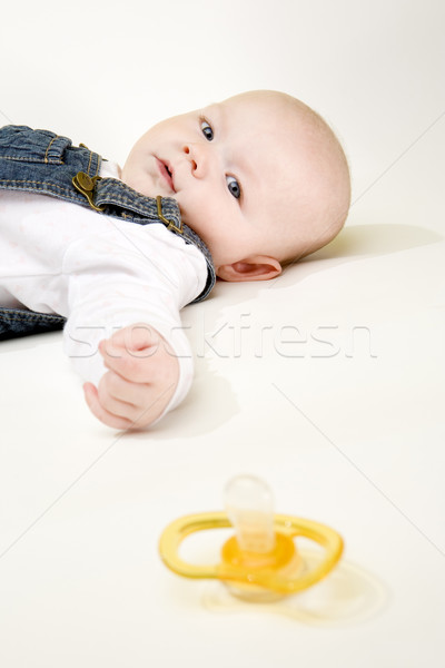 portrait of lying down baby girl with a pacifier Stock photo © phbcz