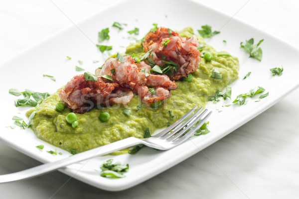 mashed peas with fried pancetta Stock photo © phbcz