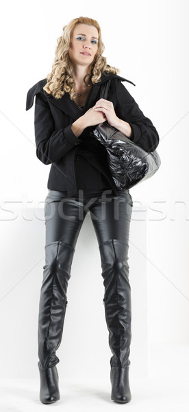 standing woman in black clothes with a handbag Stock photo © phbcz