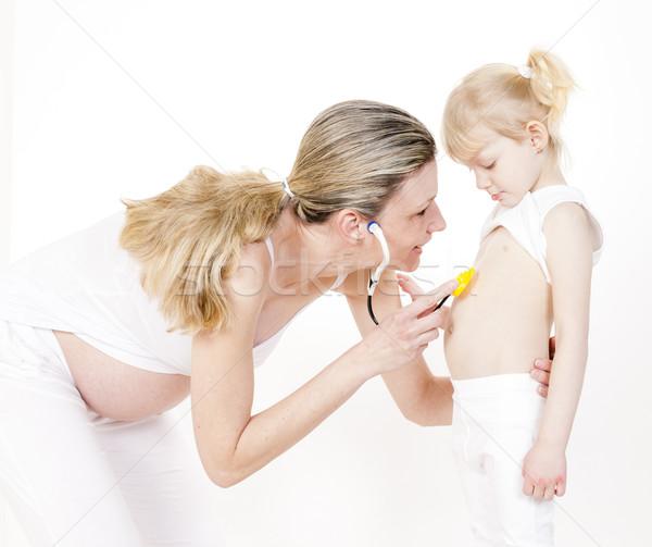 Little girl grávida mãe estetoscópio mulheres criança Foto stock © phbcz