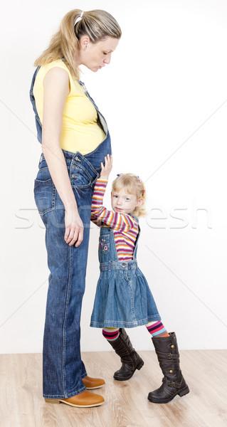 Bambina incinta madre donne bambino jeans Foto d'archivio © phbcz