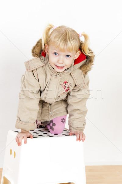 Kislány térdel zsámoly lány gyermek gyerek Stock fotó © phbcz
