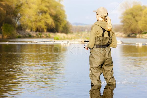 Mulher pescaria rio primavera mulheres relaxar Foto stock © phbcz