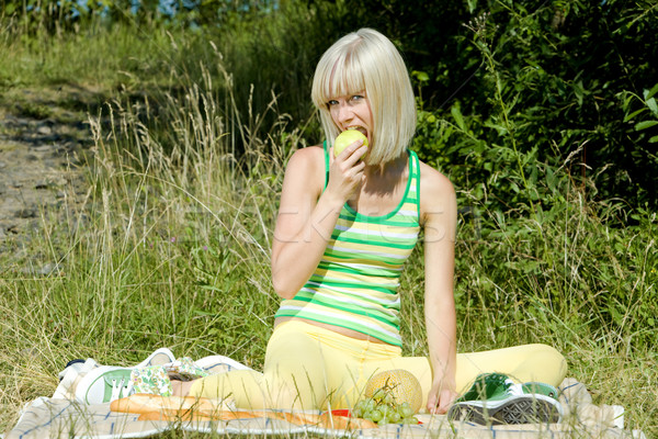 woman with apple at a picnic Stock photo © phbcz