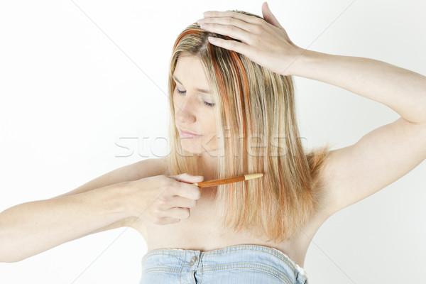 portrait of woman combing long hair Stock photo © phbcz