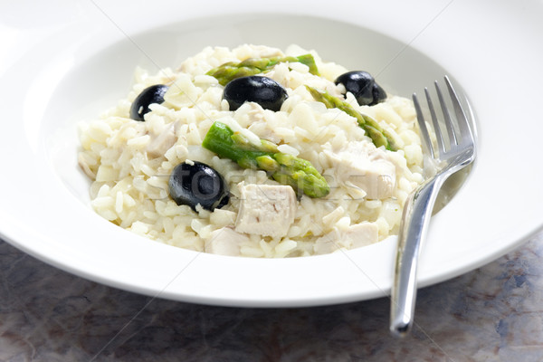 chicken rissoto with asparagus and olives Stock photo © phbcz