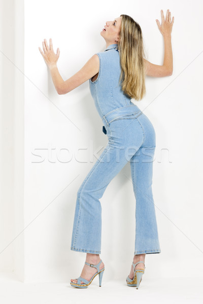 standing woman wearing denim overalls and summer shoes Stock photo © phbcz