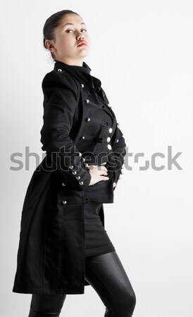 portrait of standing young woman wearing extravagant clothes Stock photo © phbcz