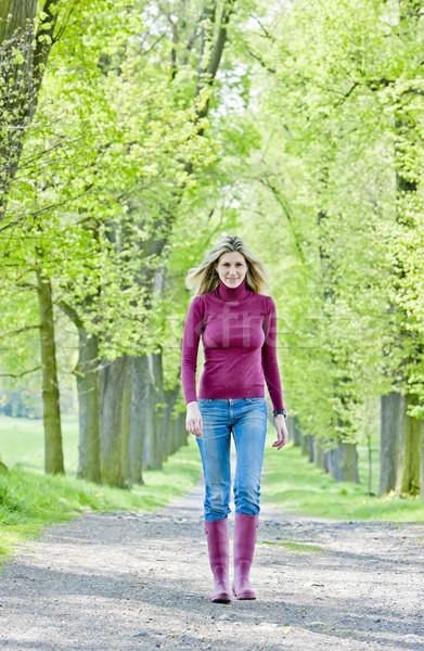 Nő visel gumicsizma tavasz sikátor fa Stock fotó © phbcz