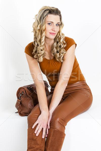 ストックフォト: 肖像 · 座って · 女性 · 着用 · ブラウン · 服