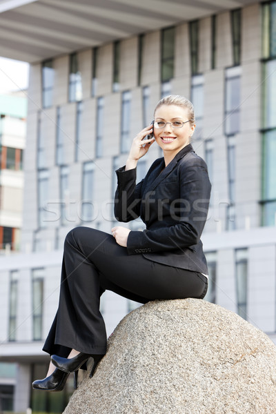 telephoning young businesswoman Stock photo © phbcz