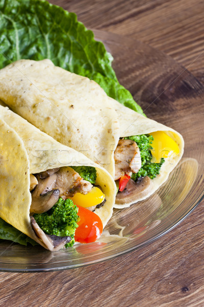 tortilla filled with chicken meat and vegetables Stock photo © phbcz