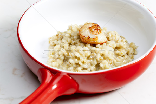 Stock photo: fried Saint Jacques mollusc with pearl barley risotto