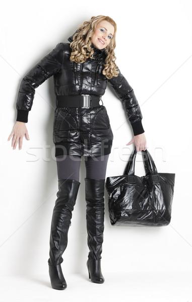 standing woman wearing black clothes holding a handbag Stock photo © phbcz