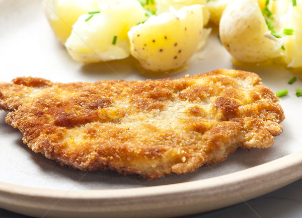 fried pork fillet with boiled unpeeled potatoes Stock photo © phbcz