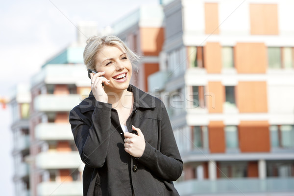 portrait of telephoning young businesswoman Stock photo © phbcz