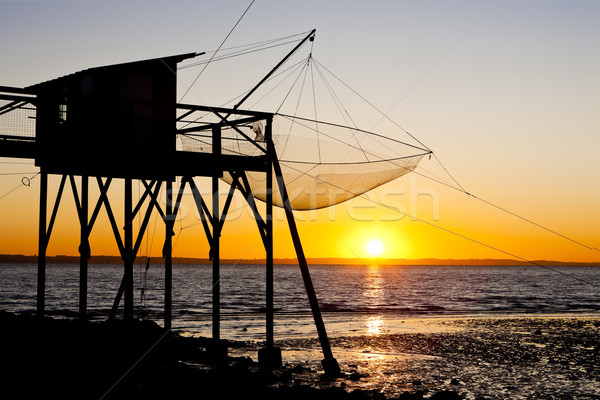 pier with fishing net during sunrise, Gironde Department, Aquita Stock photo © phbcz
