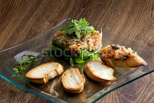 salmon tartar with ruccola Stock photo © phbcz