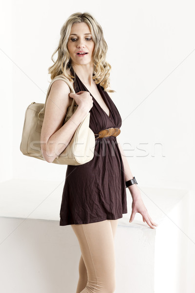 portrait of standing woman wearing summer clothes with a handbag Stock photo © phbcz