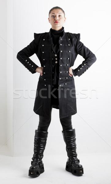 Em pé mulher extravagante roupa botas Foto stock © phbcz
