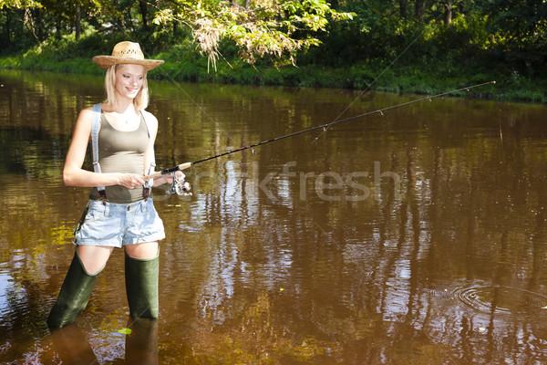 woman fishing in Jizera river, Czech Republic Stock photo © phbcz
