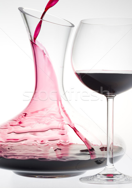 wine glass and carafe with red wine Stock photo © phbcz