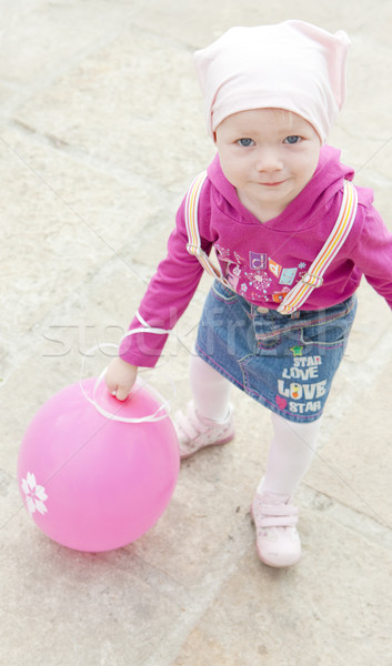 toddler with pink balloon Stock photo © phbcz