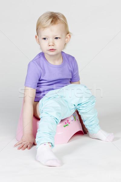little girl using potty Stock photo © phbcz