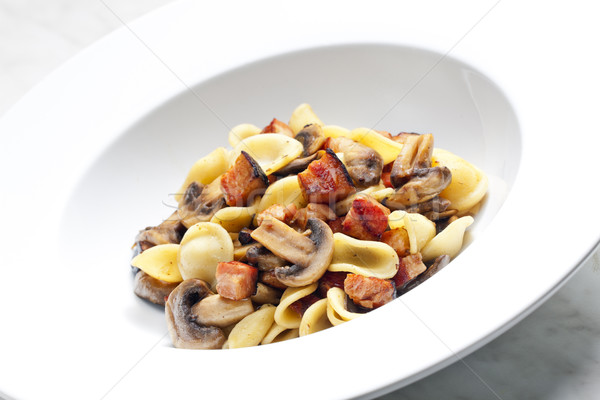 pasta orecchiette with fried champignons and bacon Stock photo © phbcz