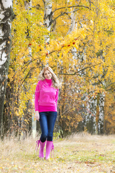 woman wearing rubber boots in autumnal nature Stock photo © phbcz