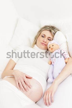 Donna incinta riposo letto bambola donne bianco Foto d'archivio © phbcz