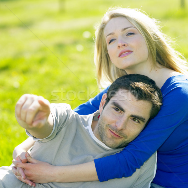 couple sitting on meadow Stock photo © phbcz