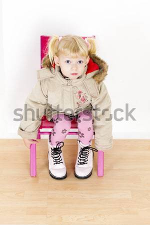 Toddler sitting on chair with toys stock photo richard for Toddler sitting chair