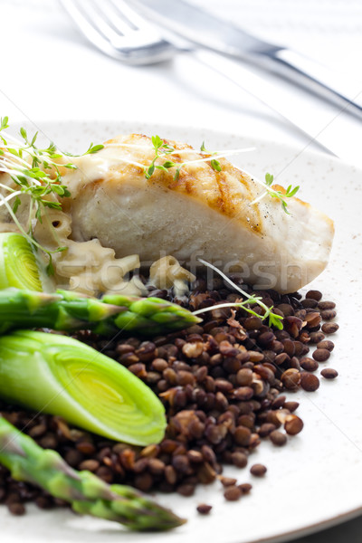 butterfish with green lentils, leek and green asparagus Stock photo © phbcz