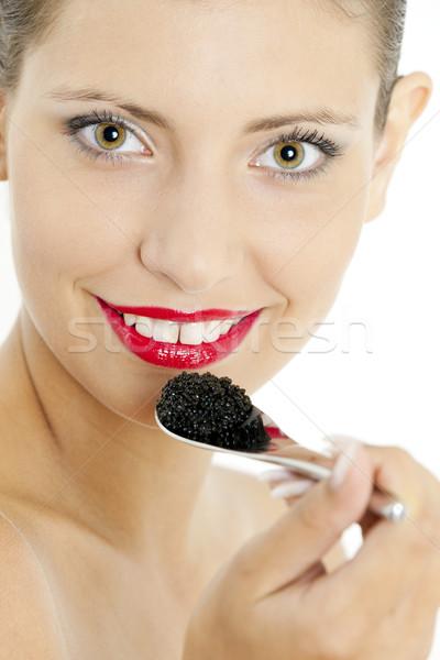 Stockfoto: Portret · vrouw · zwarte · kaviaar · jonge · eten