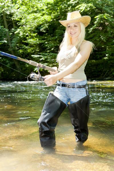 Kobieta połowów rzeki kobiet hat kobiet Zdjęcia stock © phbcz